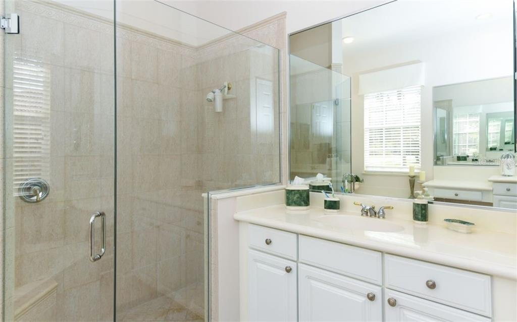 Master bath with 2 separate vanities and frameless shower door! - Single Family Home for sale at 8473 Eagle Preserve Way, Sarasota, FL 34241 - MLS Number is A4425945
