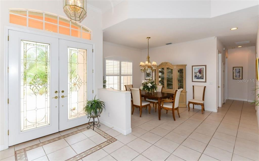 Large dining room, open to the living room. - Single Family Home for sale at 8473 Eagle Preserve Way, Sarasota, FL 34241 - MLS Number is A4425945
