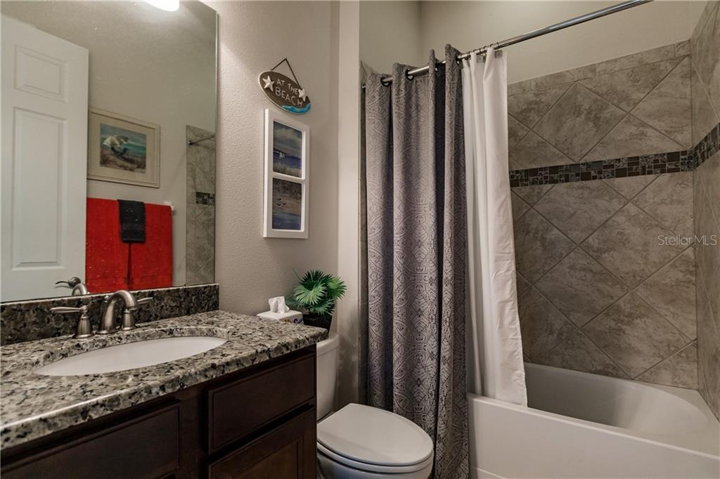 3rd full bathroom located next to the 4th bedroom. - Single Family Home for sale at 17006 1st Dr E, Bradenton, FL 34212 - MLS Number is A4432830