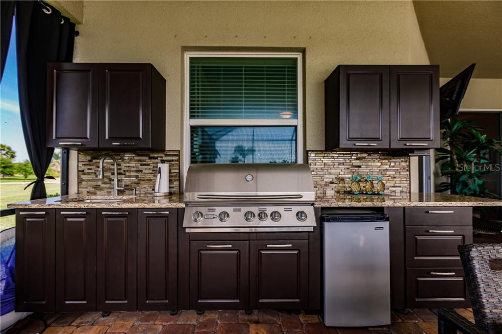 New custom outdoor kitchen with granite counters, polymer cabinets, sink, grill and refrigerator is ready for all of your pool parties. - Single Family Home for sale at 17006 1st Dr E, Bradenton, FL 34212 - MLS Number is A4432830