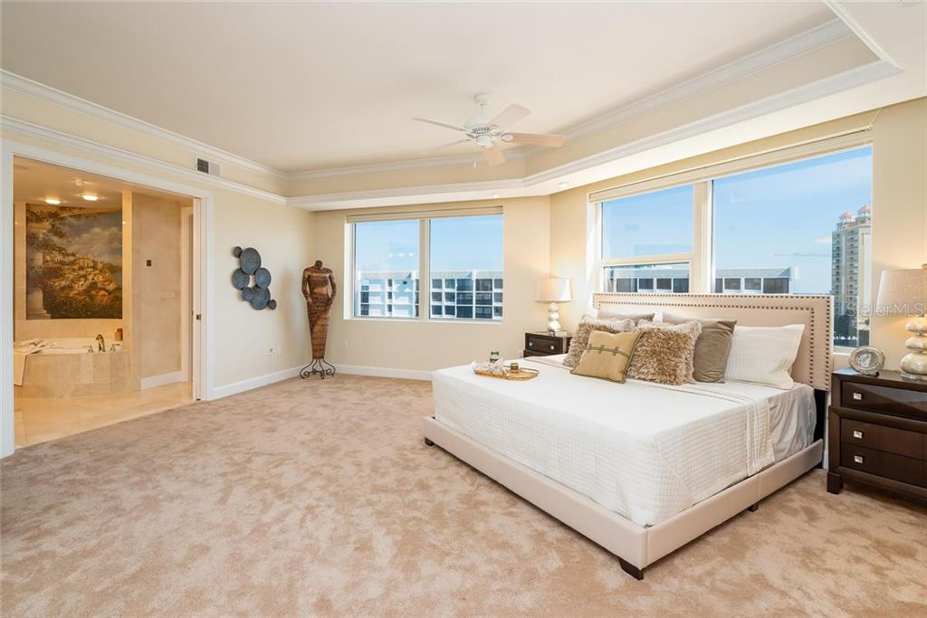Expansive Master Suite includes a luxurious ensuite, walk-in closet with fabulous built-ins, seating area to relish the views and formal office. - Condo for sale at 128 Golden Gate Pt #902a, Sarasota, FL 34236 - MLS Number is A4433296