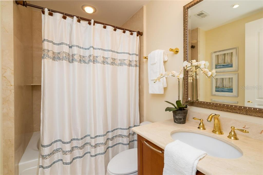 Private ensuite to Guest Bedroom #2. - Condo for sale at 128 Golden Gate Pt #902a, Sarasota, FL 34236 - MLS Number is A4433296