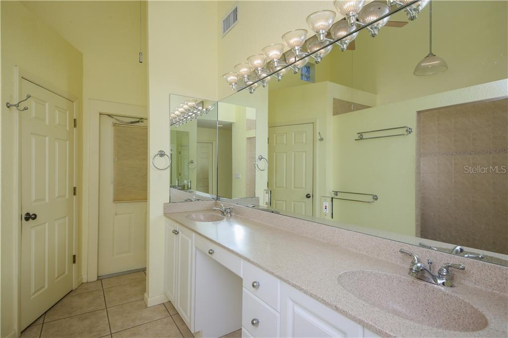 Master bathroom w/walk in shower and large vanity w/double sinks - Single Family Home for sale at 7611 Alhambra Dr, Bradenton, FL 34209 - MLS Number is A4434753