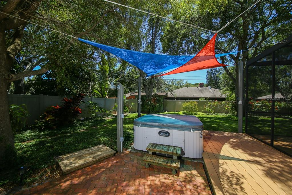 Patio w/hot tub and deck area for a grill - Single Family Home for sale at 7611 Alhambra Dr, Bradenton, FL 34209 - MLS Number is A4434753