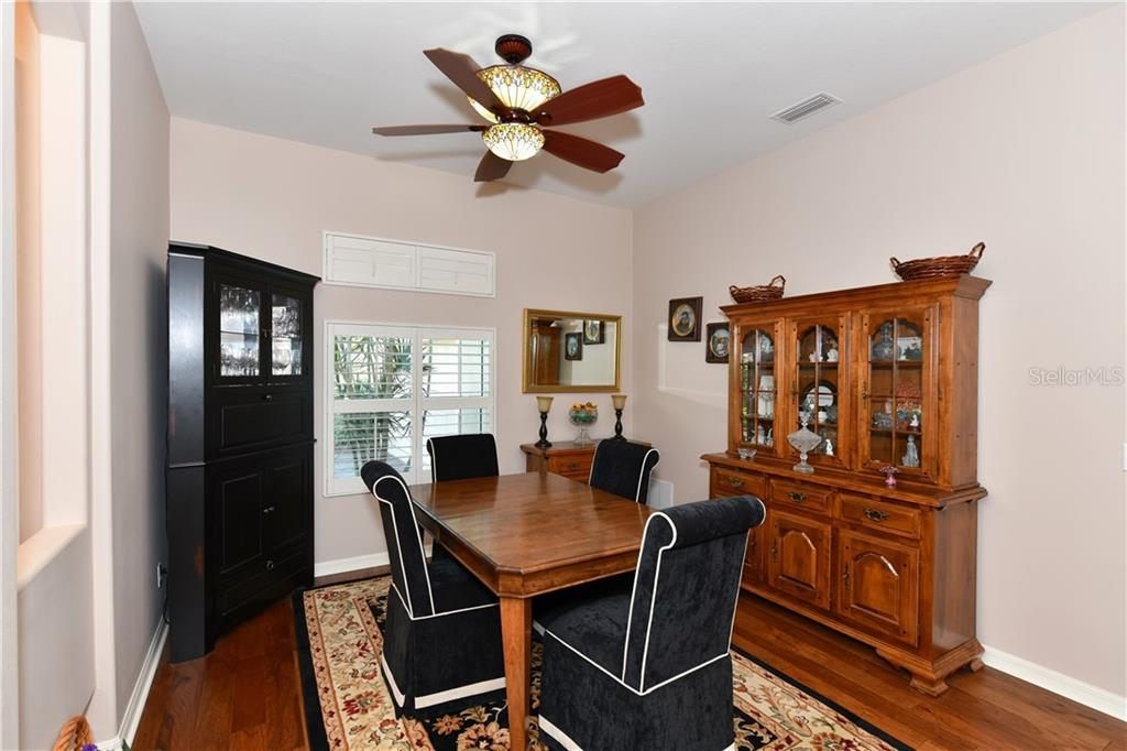 Dining room, elegant lighted fan, impact window - Single Family Home for sale at 2745 Harvest Dr, Sarasota, FL 34240 - MLS Number is A4436381