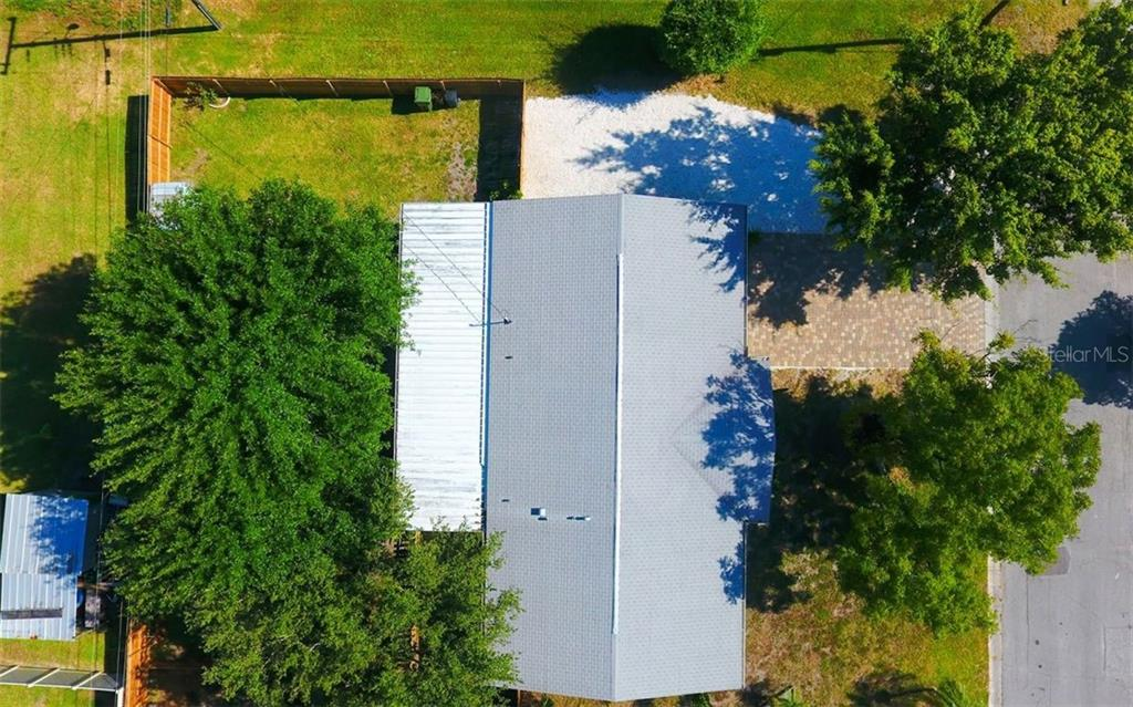 Aerial of the lot & view of the roof. - Single Family Home for sale at 120 23rd Street Ct Ne, Bradenton, FL 34208 - MLS Number is A4438232