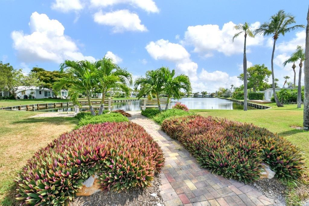 Lake Walkway - Villa for sale at 717 Spanish Dr N, Longboat Key, FL 34228 - MLS Number is A4438337
