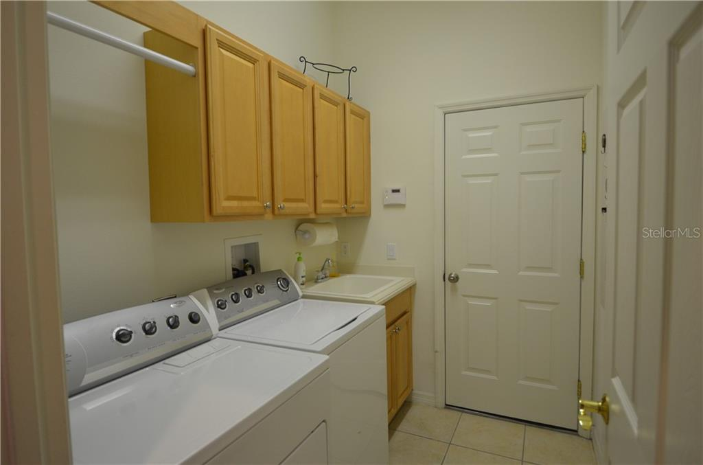 Nice laundry room, with sink, cabinets, hanging area. - Single Family Home for sale at 3632 Summerwind Cir, Bradenton, FL 34209 - MLS Number is A4438762