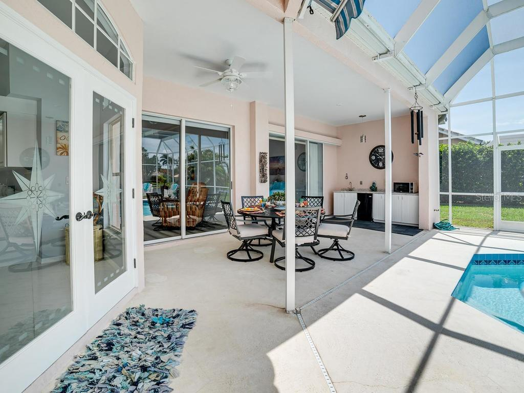 Covered area by the pool.  Lots of room for entertaining! - Single Family Home for sale at 4117 Via Mirada, Sarasota, FL 34238 - MLS Number is A4438764
