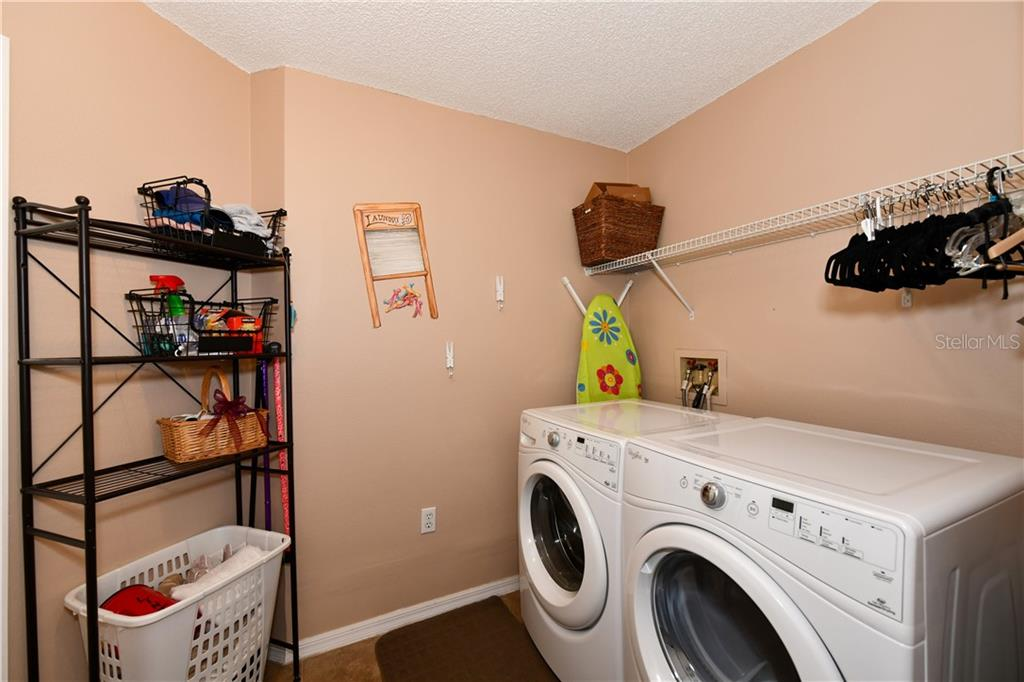 Large laundry room with plenty of space to turnaround...  Nice w/d front load appliances. - Single Family Home for sale at 4074 Via Mirada, Sarasota, FL 34238 - MLS Number is A4439141