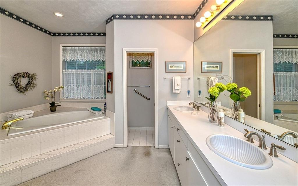 Master bathroom with separate tub & shower, double sinks and private commode area - Single Family Home for sale at 2316 Nw 85th St Nw, Bradenton, FL 34209 - MLS Number is A4445702