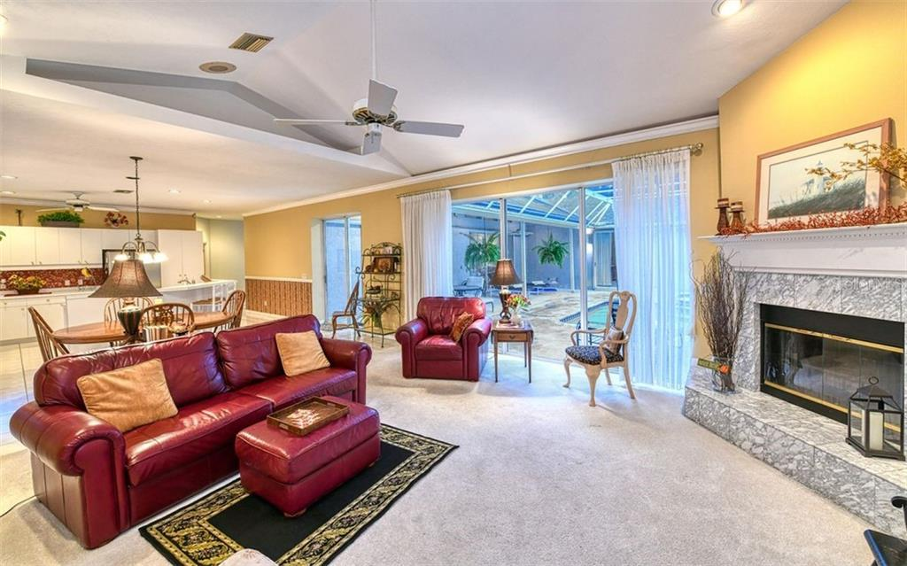 Family Room with fireplace and sliders to the pool - Single Family Home for sale at 2316 Nw 85th St Nw, Bradenton, FL 34209 - MLS Number is A4445702