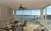 Enclosed balcony with bay views - Condo for sale at 1260 Dolphin Bay Way #401, Sarasota, FL 34242 - MLS Number is A4173008