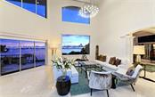 Stunning living room with endless views of Sarasota Bay & fantastic sunsets. - Single Family Home for sale at 2145 Alameda Ave, Sarasota, FL 34234 - MLS Number is A4414337
