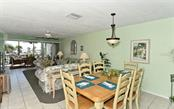 Open Dining and Living Room. - Condo for sale at 797 Beach Rd #215, Sarasota, FL 34242 - MLS Number is A4430524