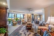 This lanai was enclosed making main living room even bigger. - Condo for sale at 20 Whispering Sands Dr #102 & 103, Sarasota, FL 34242 - MLS Number is A4441587