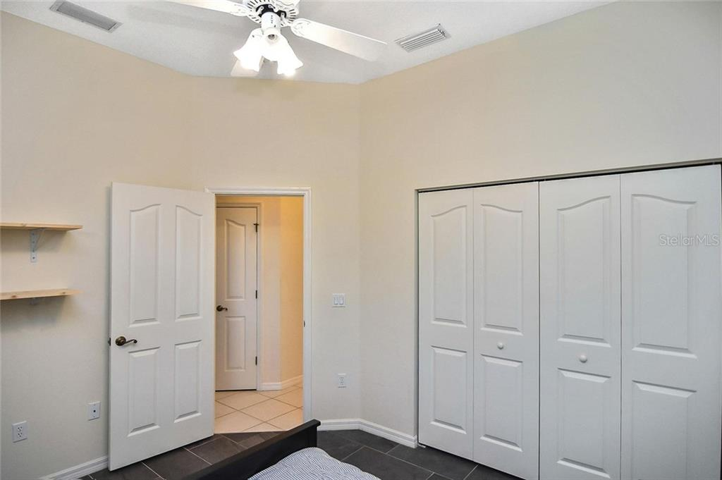 Bedroom 3 - Single Family Home for sale at 724 Silk Oak Dr, Venice, FL 34293 - MLS Number is N6102801