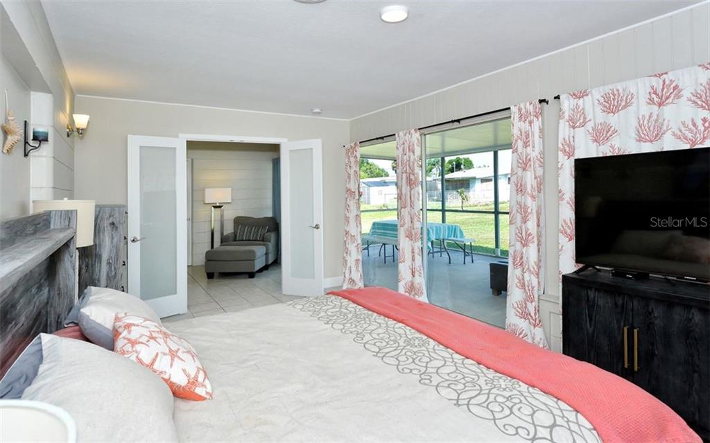 Bedroom to lanai and study/den - Single Family Home for sale at 227 Redwood Rd, Venice, FL 34293 - MLS Number is N6103942