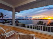 Sunset view from master bedroom deck - Single Family Home for sale at 743 Eagle Point Dr, Venice, FL 34285 - MLS Number is N6101092